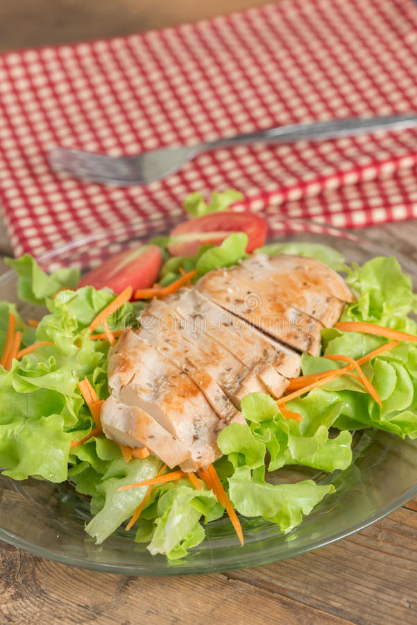 Fresh salad with grilled chicken breast, lettuce and tomato. stock photos