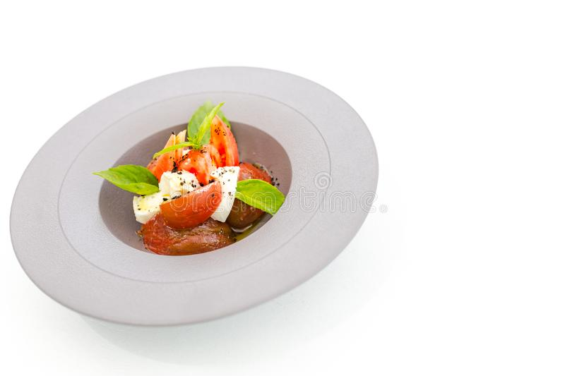 Gourmet food, healthy food. Tomato and mozzarella salad with balsamic sauce royalty free stock image