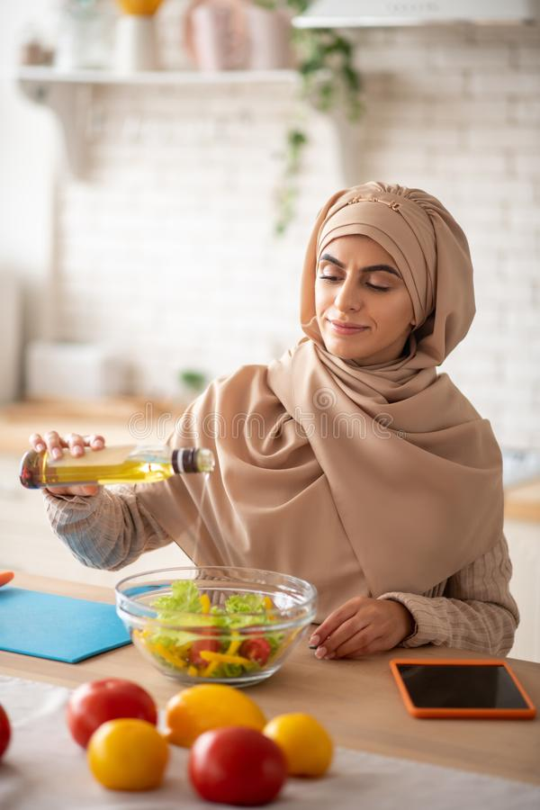 Muslim woman felling satisfied with her salad royalty free stock photos