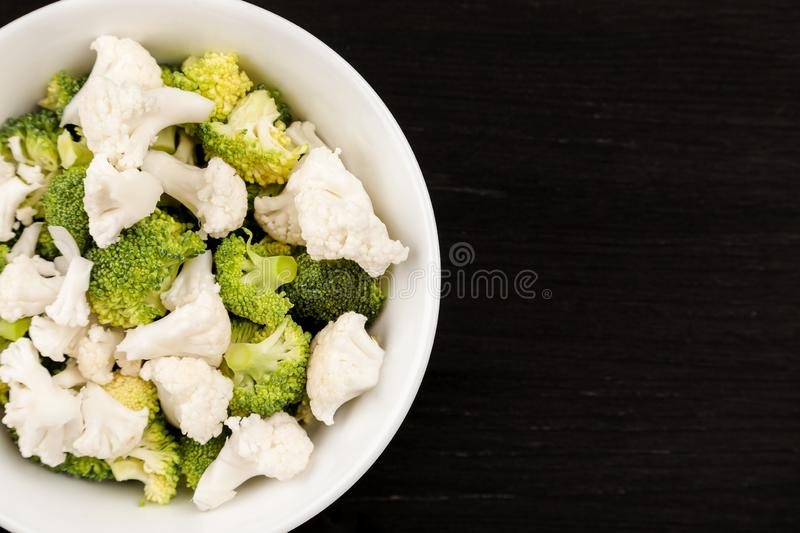 Fresh salad with raw broccoli and cauliflower in a white dish stock images