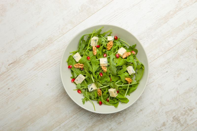 Fresh salad with tomatoes , blue cheese and nutsFresh salad with tomatoes , blue cheese and nuts stock image
