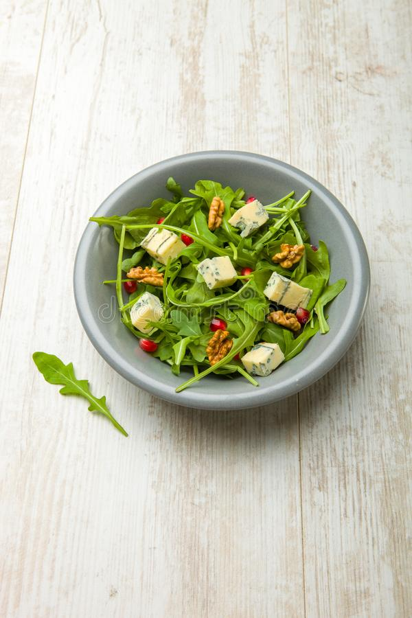 Fresh salad with tomatoes , blue cheese and nutsFresh salad with tomatoes , blue cheese and nuts stock photo