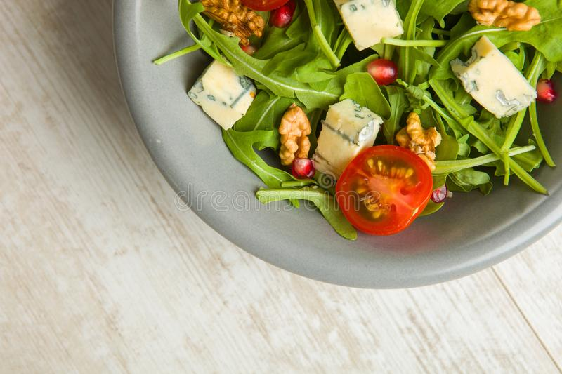 Fresh salad with tomatoes , blue cheese and nutsFresh salad with tomatoes , blue cheese and nuts royalty free stock image