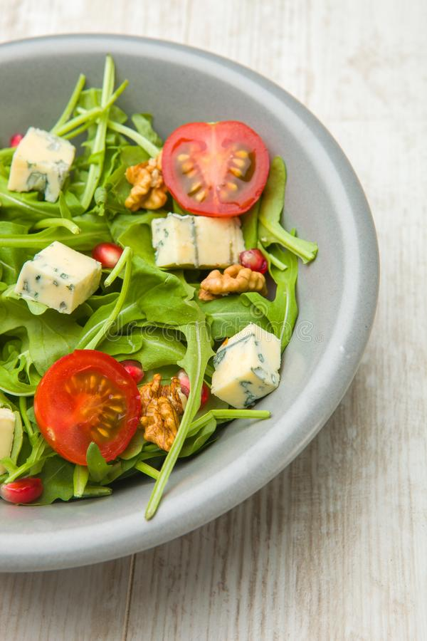 Fresh salad with tomatoes , blue cheese and nutsFresh salad with tomatoes , blue cheese and nuts royalty free stock images