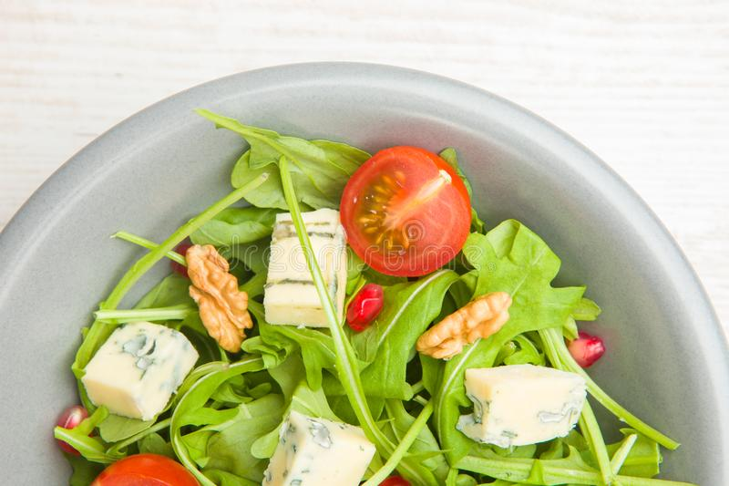 Fresh salad with tomatoes , blue cheese and nutsFresh salad with tomatoes , blue cheese and nuts royalty free stock photography