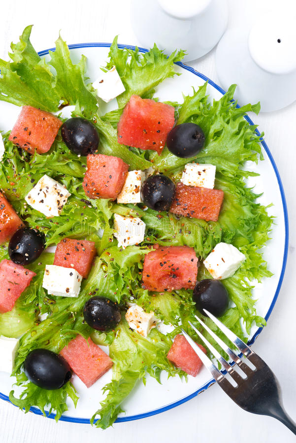 Fresh salad with watermelon, feta cheese and olives, close-up royalty free stock images