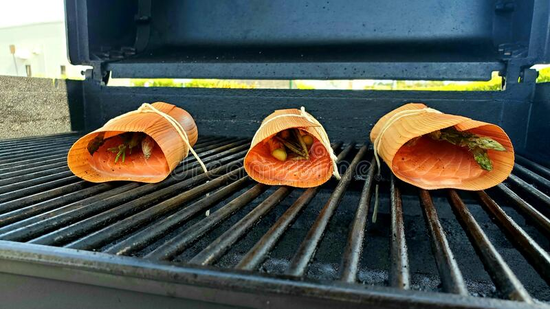 Salmon with asparagus on the grill royalty free stock photography