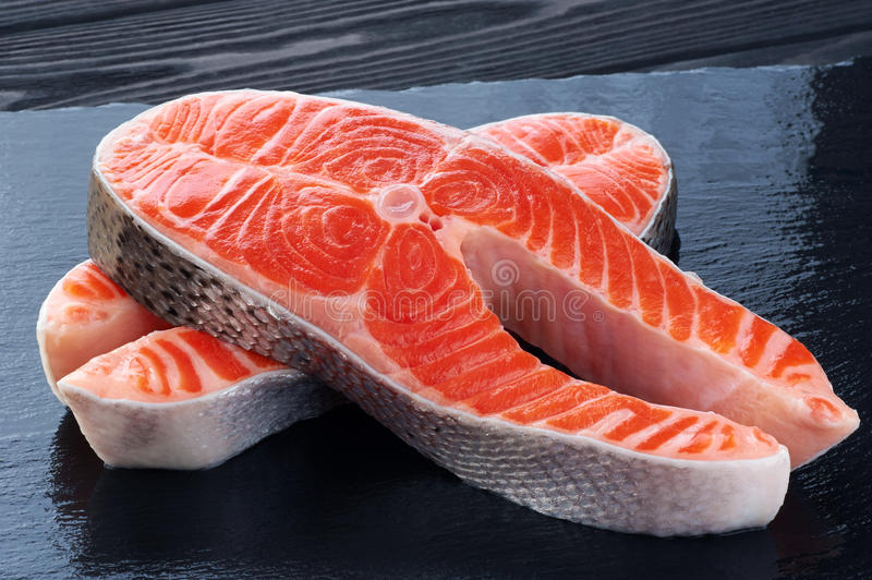 Fresh salmon on a dark background. Close up stock image