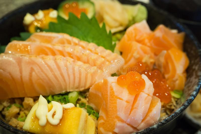 Fresh salmon with egg on top of japanese rice in bowl royalty free stock images