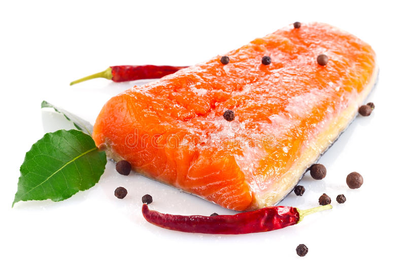 Fresh salmon fillet with salt and spice. On white background royalty free stock photos