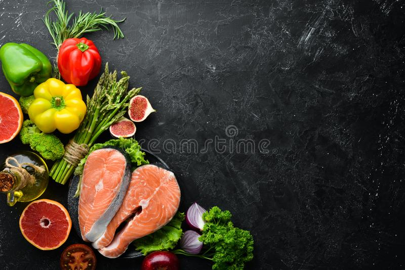 Fresh salmon fillet with vegetables. Healthy eating concept. Top view. Free copy space royalty free stock photos