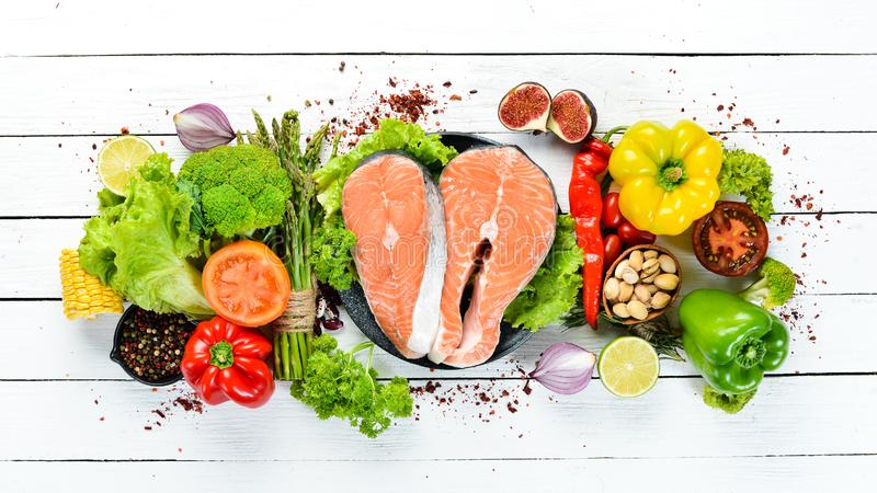 Fresh salmon fillet with vegetables. Healthy eating concept. Top view. Free copy space stock photos