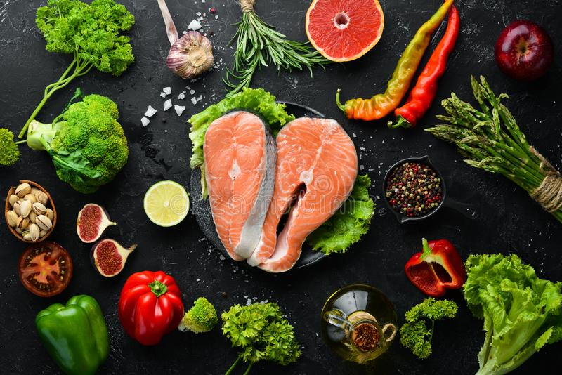 Fresh salmon fillet with vegetables. Healthy eating concept. Top view. Free copy space royalty free stock photography