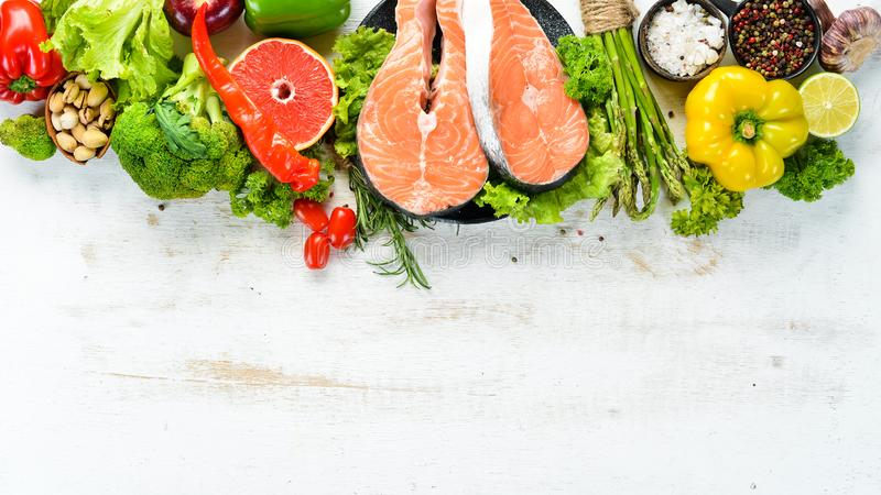 Fresh salmon fillet with vegetables. Healthy eating concept. Top view. Free copy space stock photography