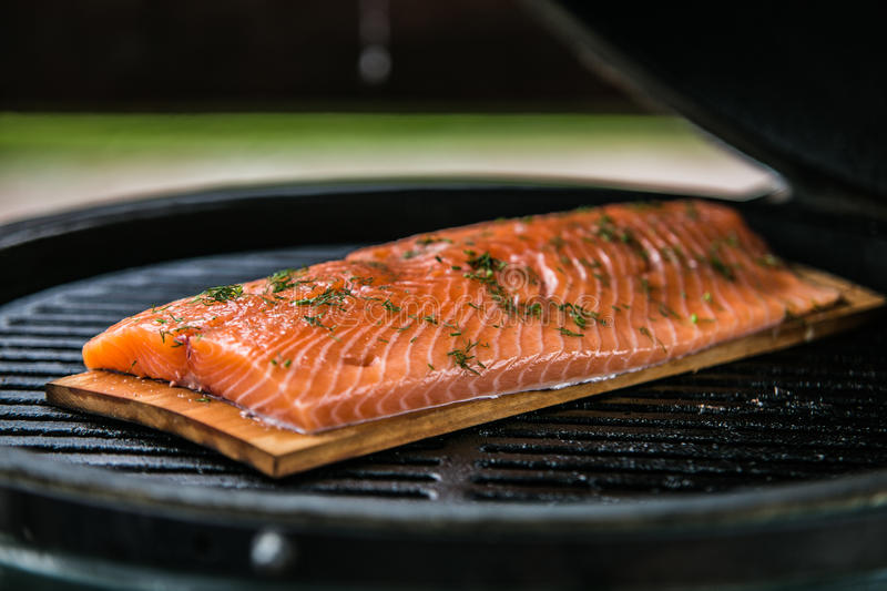 Fresh salmon fillets being cooked on grill.  royalty free stock photo