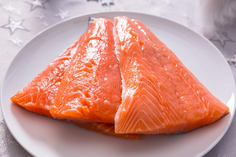 Fresh salmon fillets for christmas dinner royalty free stock photo