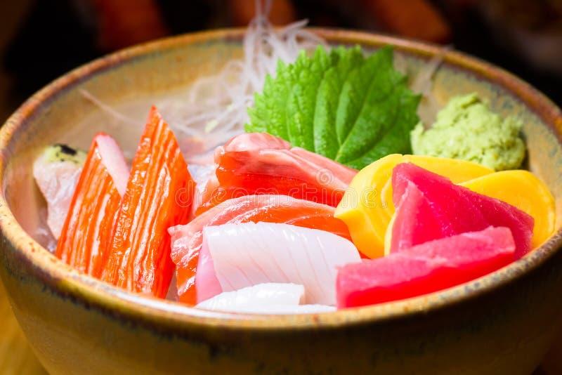 Fresh salmon fish slice with tuna set.Sushi Set Sashimi and sushi rolls served on black stone slate.Close Up. stock photo