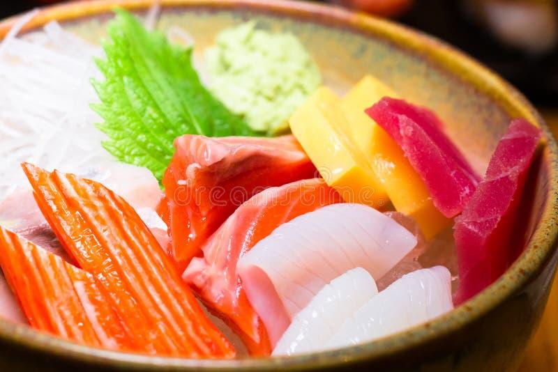 Fresh salmon fish slice with tuna set.Sushi Set Sashimi and sushi rolls served on black stone slate.Close Up. royalty free stock photography