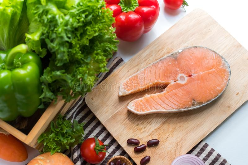 Fresh Salmon fish with vegetables for cooking steak salad. Healthy and diet food stock photography