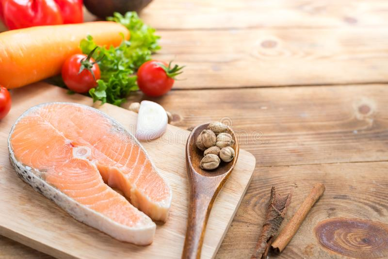 Fresh Salmon fish with vegetables for cooking steak salad. Healthy and diet food stock images