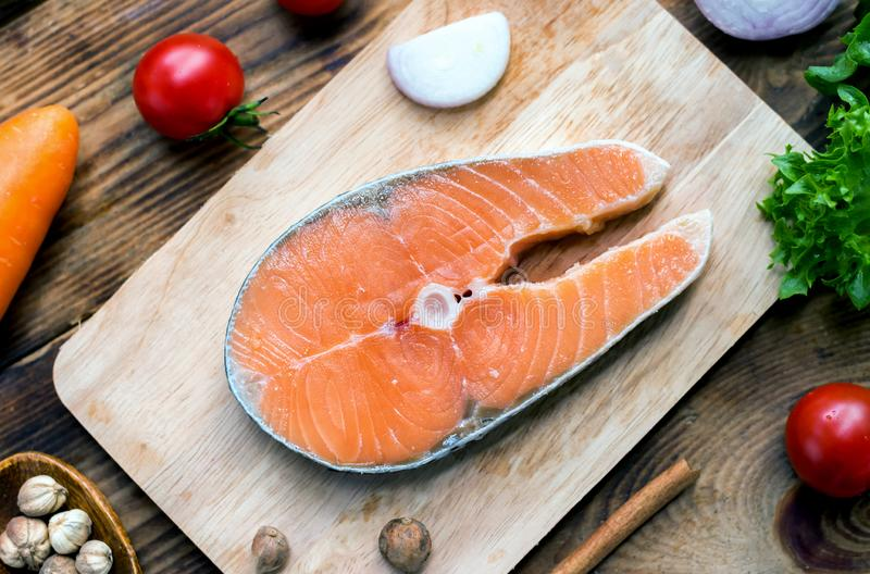 Fresh Salmon fish with vegetables for cooking steak salad. Healthy and diet food royalty free stock image