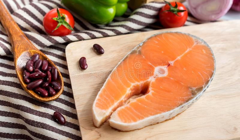 Fresh Salmon fish with vegetables for cooking steak salad. Healthy and diet food royalty free stock photography