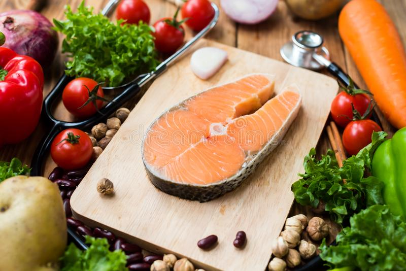Fresh Salmon fish with vegetables for cooking steak salad. Healthy and diet food royalty free stock photos