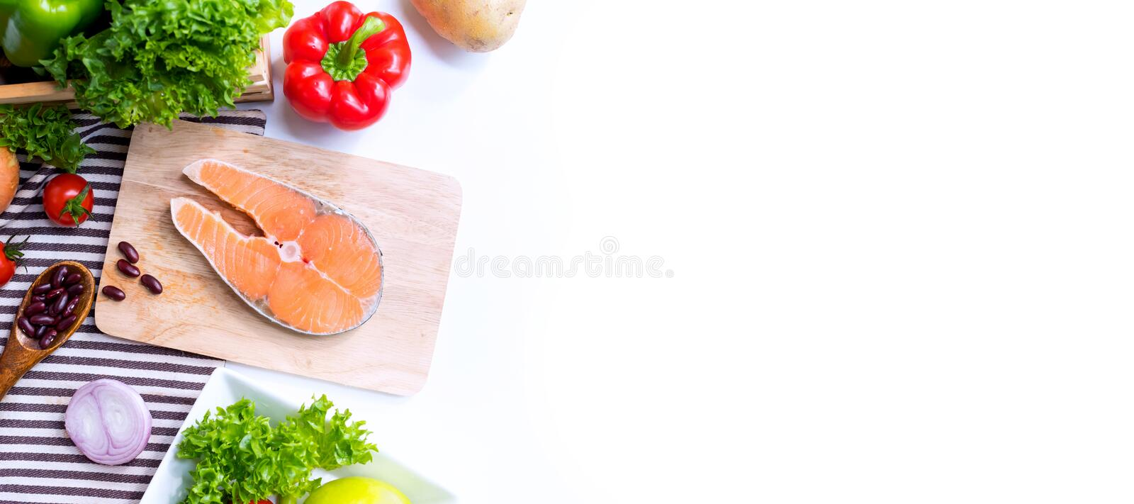 Fresh Salmon fish with vegetables for cooking steak salad. Healthy and diet food. Isolated on white background royalty free stock photos