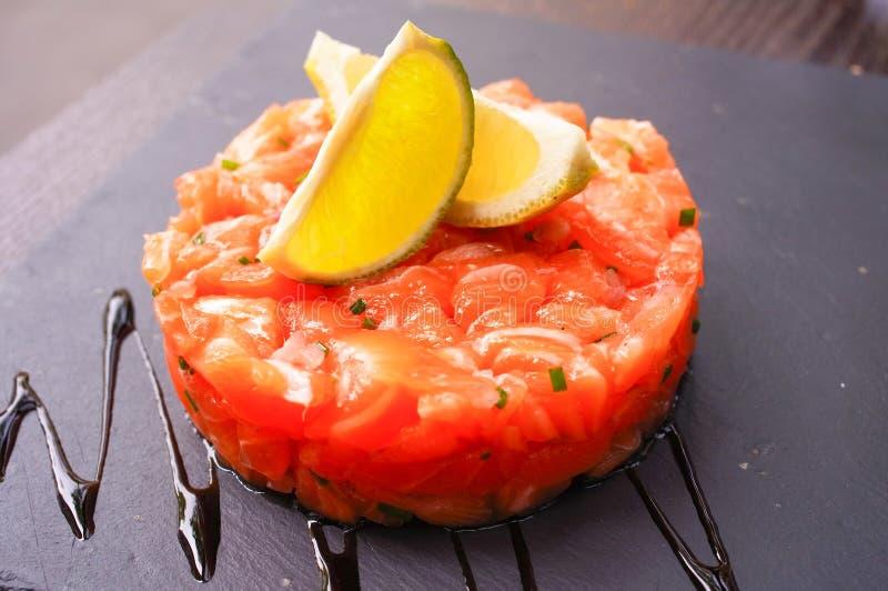 Fresh Salmon with lemon. A seafood salad with smoked salmon royalty free stock photo