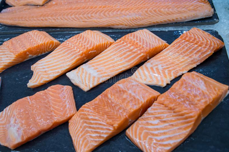 Fresh salmon. Salmon fillets for sale at a fish market displayed with a patchwork effect. royalty free stock photo