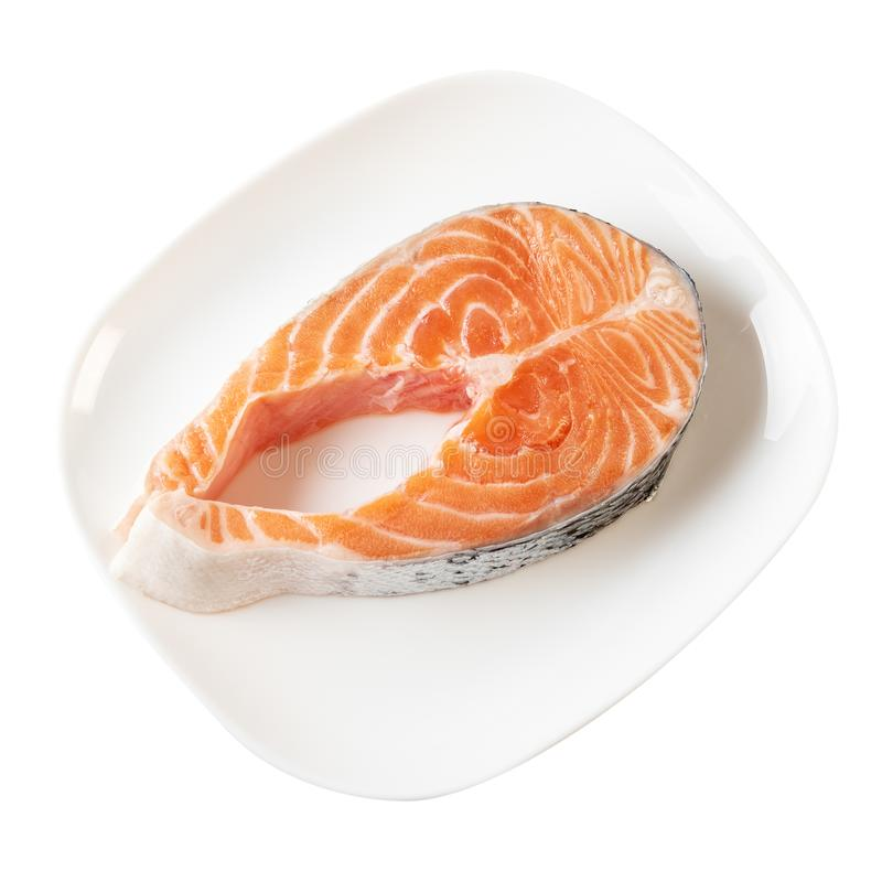 Fresh Salmon Steak On Dinner Plate Isolated On Whit royalty free stock image