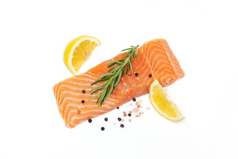 Fresh salmon steak with herbs and lemon isolated royalty free stock photography