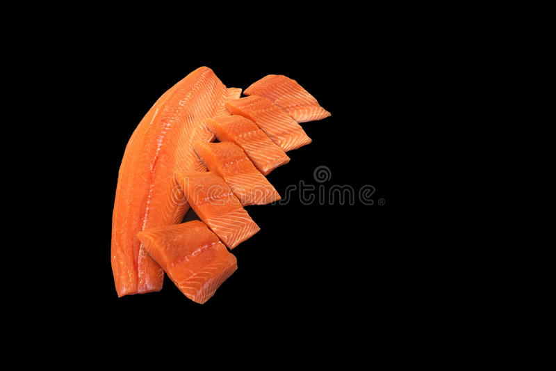 Fresh Salmon steak isolated. In black background royalty free stock image