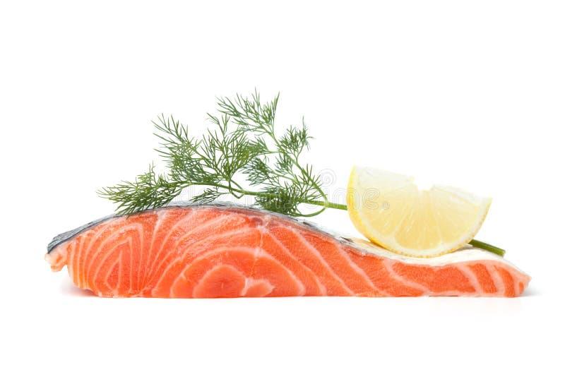 Fresh salmon steak with lemon slice and dill royalty free stock photos