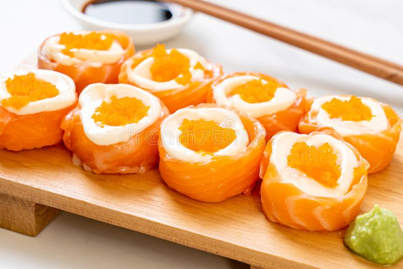 fresh salmon sushi roll with mayonnaise and shrimp egg royalty free stock photo