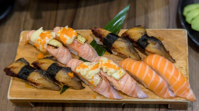 Fresh salmon sushi , salmon maki roll Japanese food restaurant, stock photo