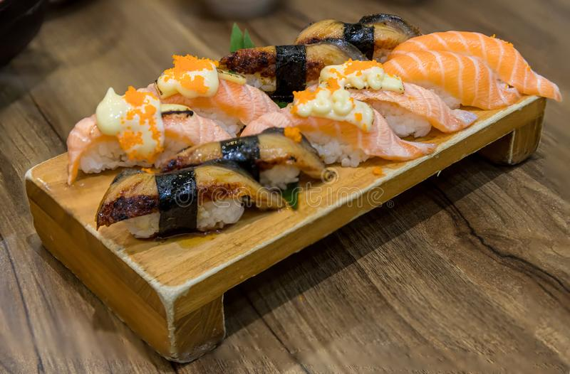 Fresh salmon sushi , salmon maki roll Japanese food restaurant,. Salmon sushi on plate. Sushi platter with a mixed variety of the Japanese delicacy at a buffet stock images