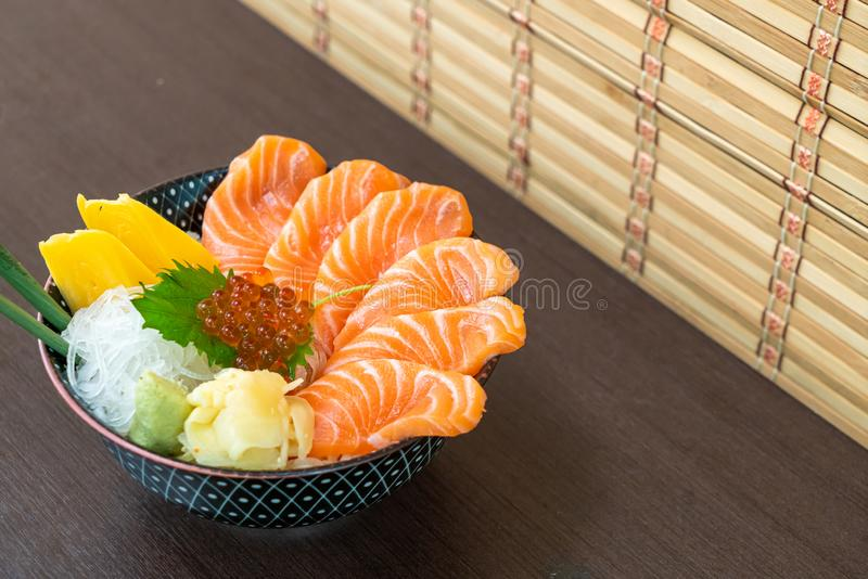 Fresh salmon on topped rice bowl (donburi. ) - Japanese food style stock photography