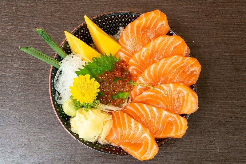 Fresh salmon on topped rice bowl (donburi. ) - Japanese food style stock photo