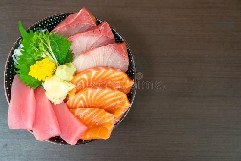 Fresh salmon, tuna and hamachi on topped rice bowl (donburi. ) - Japanese food style royalty free stock image