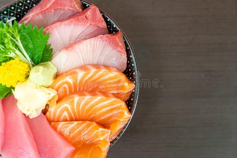 Fresh salmon, tuna and hamachi on topped rice bowl (donburi. ) - Japanese food style stock photography