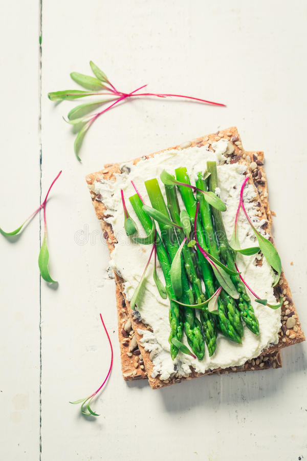 Fresh sandwich with asparagus and fromage cheese. On old white table stock photos