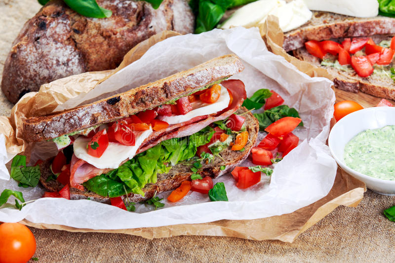 Fresh Sandwich with Bacon Lettuce Tomato and Mozzarella stock photos