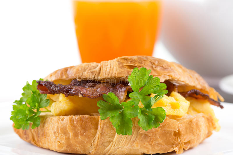 Fresh sandwich with bacon and scrambled eggs royalty free stock photo