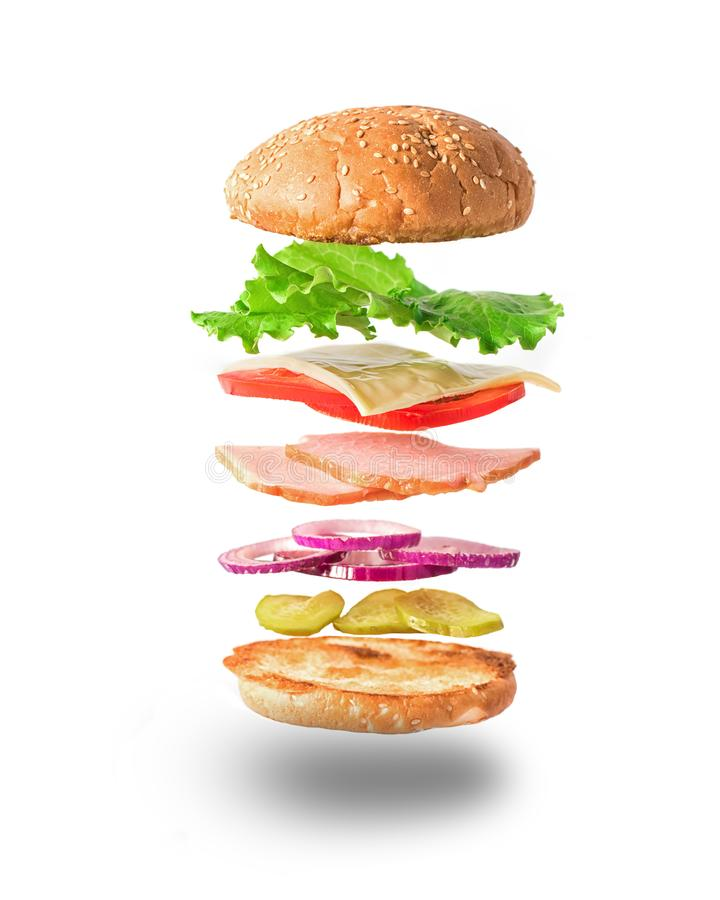 Fresh sandwich with flying ingredients isolated on white background royalty free stock photos