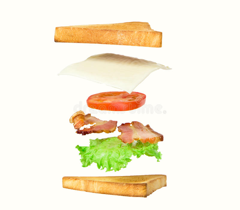 Fresh sandwich with flying ingredients isolated on white background stock image