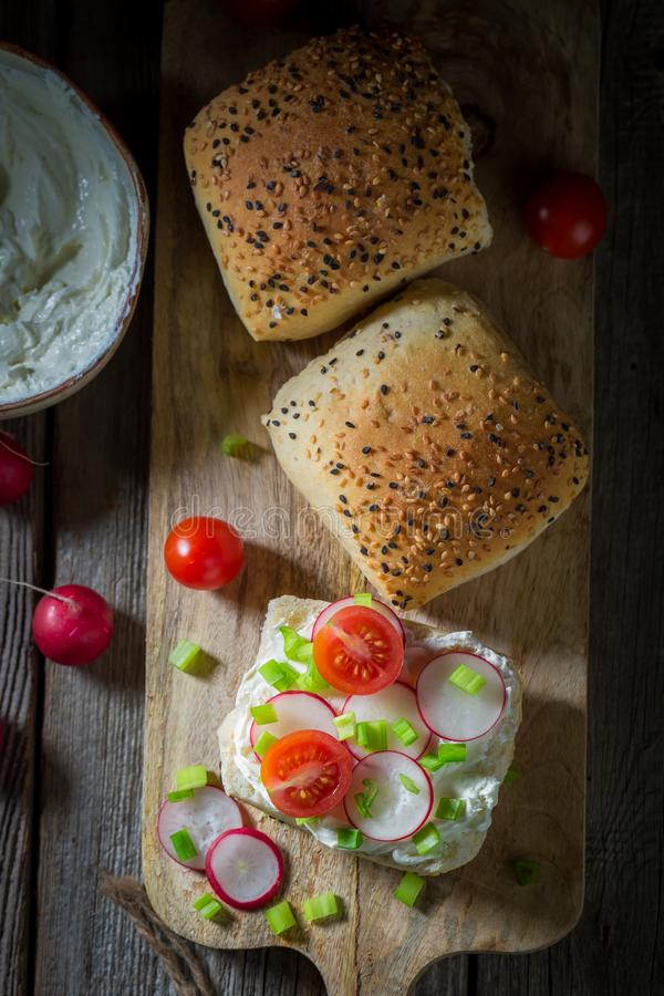 Fresh sandwich with fromage cheese and cherry tomatoes. On dark background royalty free stock photos