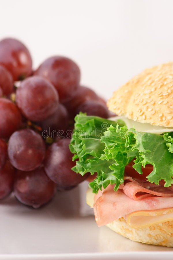 Fresh sandwich and grapes royalty free stock image