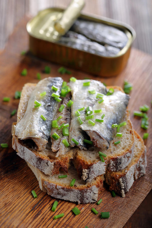 Fresh sandwich with sardines on wholegrain bread royalty free stock photo