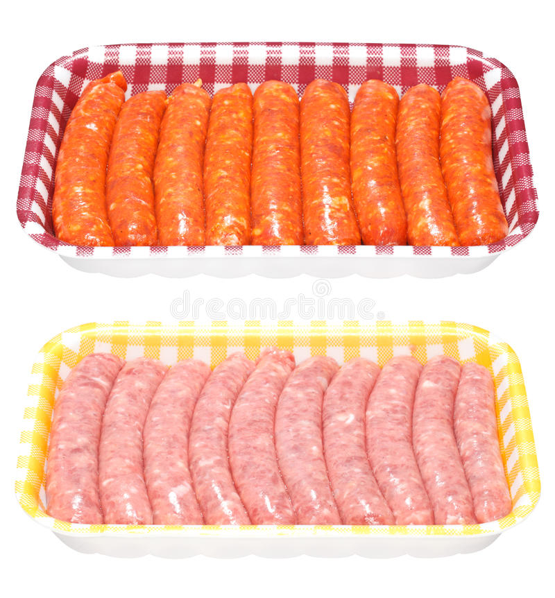 Fresh Sausages in a Tray. Fresh raw red pork sausages and pink chicken sausages packed in a tray. Isolated on white royalty free stock photo